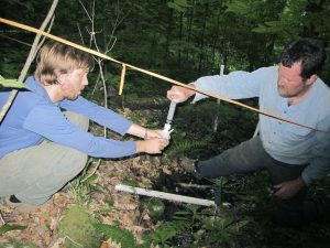JP Gannon and Scott Bailey collecting water from Watershed 3 in the Hubbard Brook Experimental Forest.  Bailey is a coauthor on the research article.